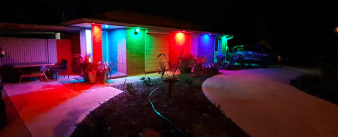 Golden Grove Electrical and Data Services. Upgrade to LED lighting blog pic of front of family home at night with colourful light under eaves.