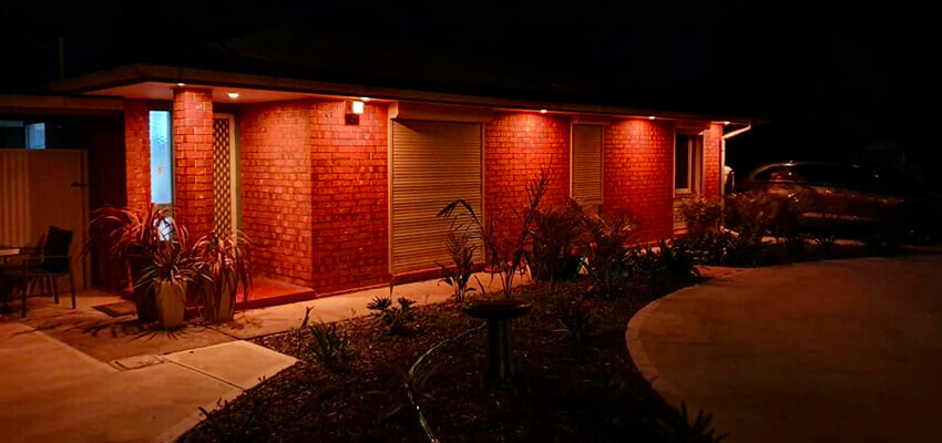 Golden Grove Electrical and Data Services. Upgrade to LED lighting blog pic of front of family home at night with white light under eaves.